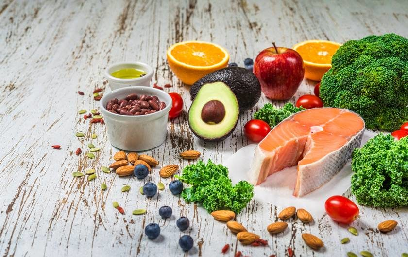Selection of fresh fruit and vegetables, salmon, beans, and nuts. Concept of cooking and eating healthy food, fitness, dieting, vegetarian, and lifestyle. Ingredients good for heart and diabetes.